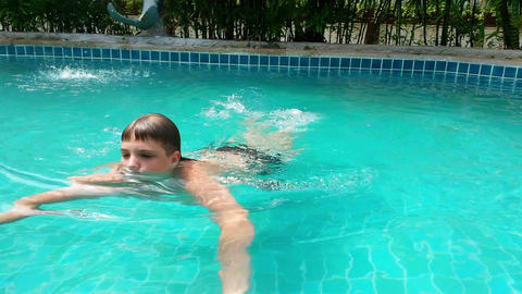 Boy In Swimming Pool Footage