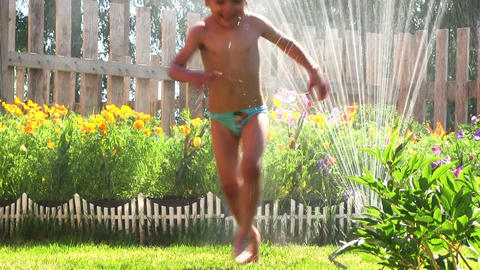 Boy Plays With Water stock footage