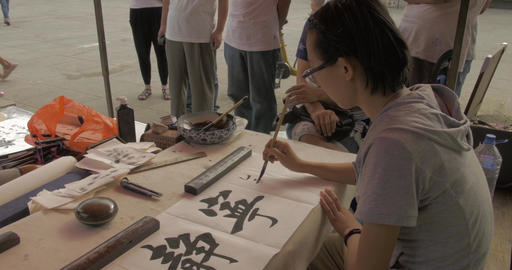 4K Calligrapher Writes Chinese Characters Footage