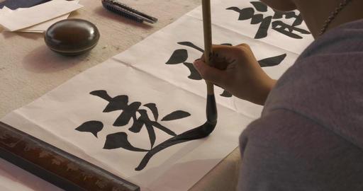 4K Calligrapher Writes Chinese Characters ビデオ
