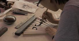 4K Calligrapher Writes on Paper Fan ビデオ