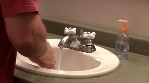 Washing hands in sink Footage