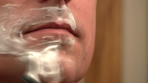 Shaving face; fast motion Footage