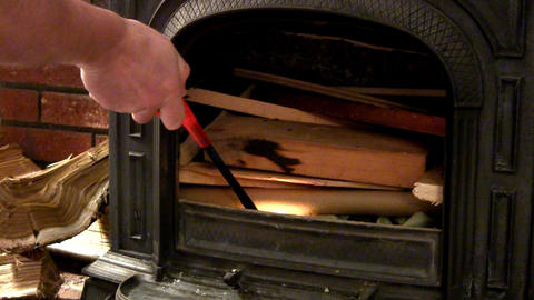 Lighting Fire In Wood Stove stock footage