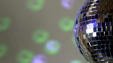 Half mirror ball; green and blue light Footage