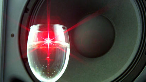 Speaker effects on wine glass with laser Footage