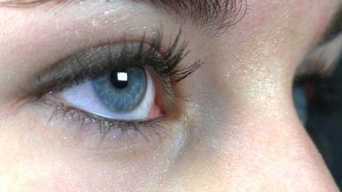 Teenage girl blue eye macro Footage