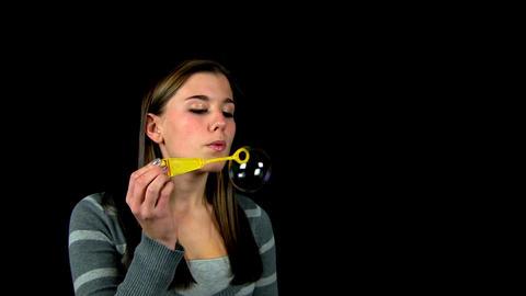 Teenage girl bubble blowing Footage