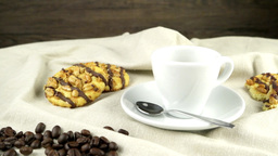 White coffee cup with coffee and around Footage