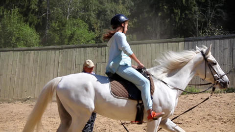 Little Girl Learning Horse Riding stock footage