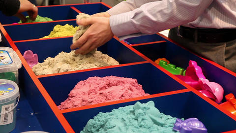Kinetic sand of different colors demonstrating Live Action