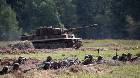 Historical reconstruction of the Second World War. Soldiers and german tank on t Live Action
