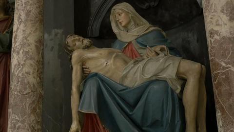 Virgin Mary Cradling Jesus Sculpture Footage