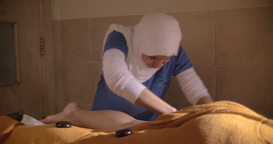 Legs hot stone massage in Asian beauty spa Footage