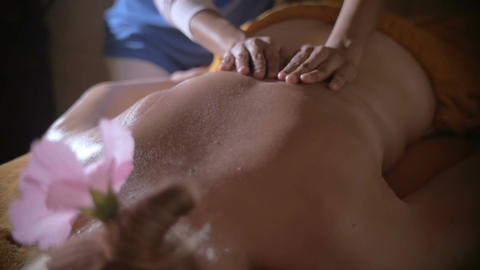 Woman getting relaxing back massage Footage