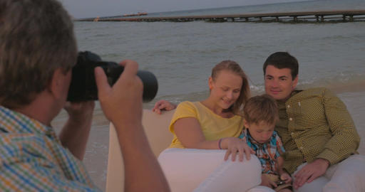 Taking pictures of the family on sea shore Footage