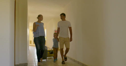 Family Rolling Trolley Bags along the Hotel Passage Footage