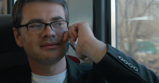 Businessman Talking on the Phone in Train Footage