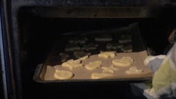 Putting baking tray with cookies into the oven Footage