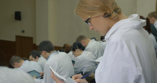 Girl medical student makes notes on the lecture Footage