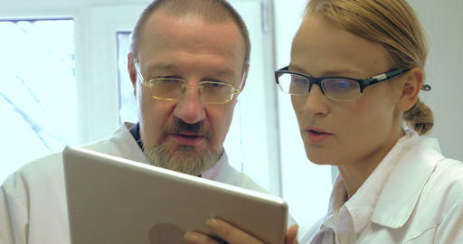 Doctors Using Tablet PC For Work stock footage