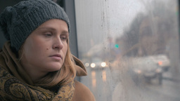 Young sad woman in the bus on a dull rainy day Footage