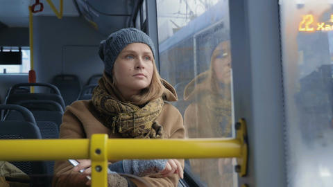 Woman passenger looking out bus window Footage