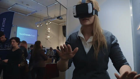 Woman Exploring Virtual Reality At Tech Ehxibition stock footage