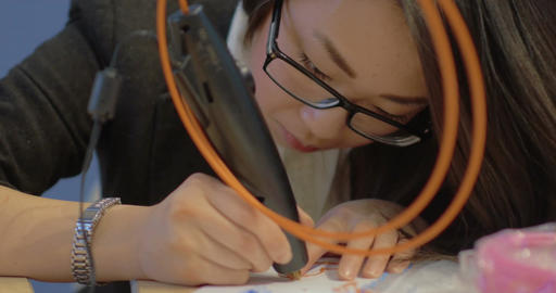 Asian Woman Drawing Heart with 3D Printing Pen Footage
