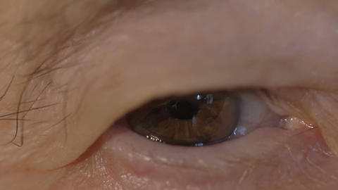 Brown eye of a senior woman Footage