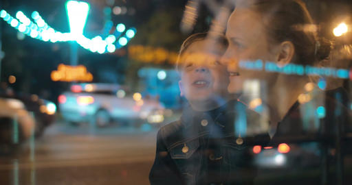 Happy mother and child talking in night city Footage