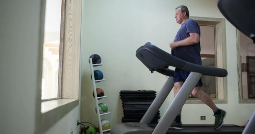Timelapse of a senior man exercising on treadmill Footage