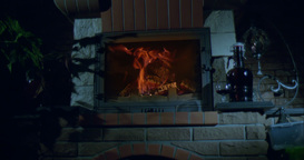 Blazing fireplace in the evening in slow motion, beautiful fire Footage