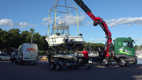 Loading a boat on a trailer. 4K Footage