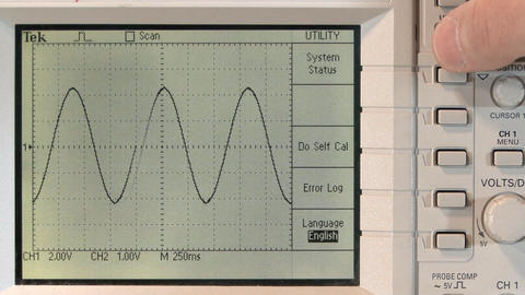 Adjusting sine wave on oscilloscope Footage