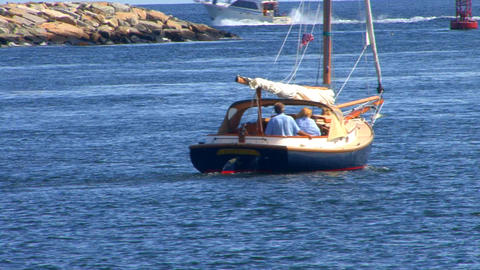 Sail Boating Couple Leaves Canal; 4 stock footage