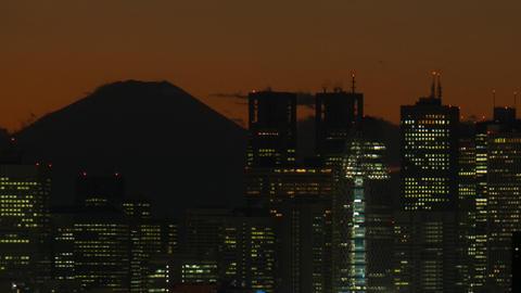 Close up Mt'FUJI and Shinjuku buildings time lapse at dusk Toyko,Japan Footage