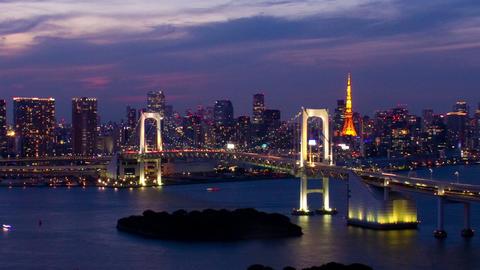 Tokyo Tower and Rainbow Bridge at night time lapse Toyko,Japan ビデオ