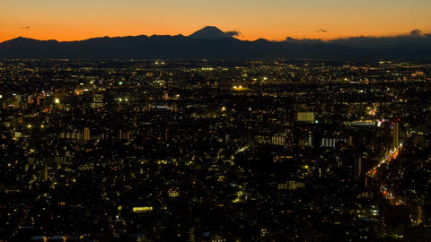 Mt'Fuji and town time lapse at dusk Tokyo,Japan Live Action