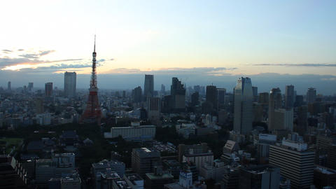 Tokyo Tower and buildings at dusk Live Action