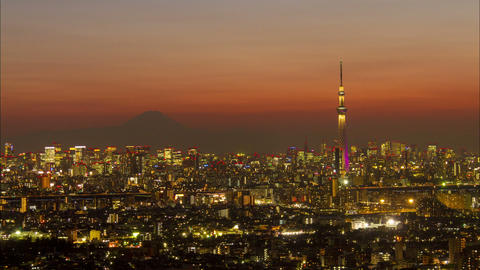 Timelapse view of Tokyo city with Tokyo Skytree and Mt Fuji on the background at Footage