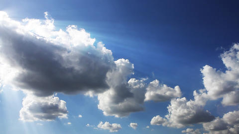 sun beam and white clouds running over blue sky Footage