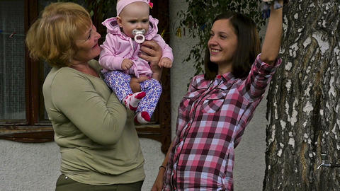 Grandmother and mother with her daughter plays Footage