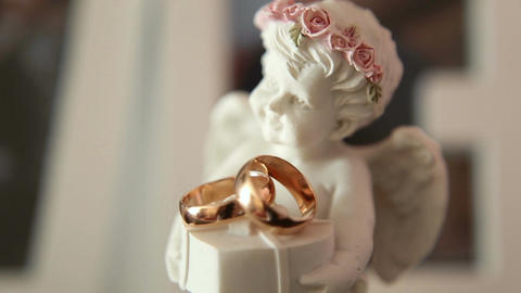 Statue Of An Angel With Wedding Rings stock footage