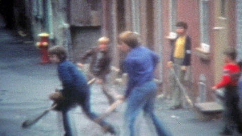 1975: Urban thug Canadian children playing street ball with lacrosse nets Footage