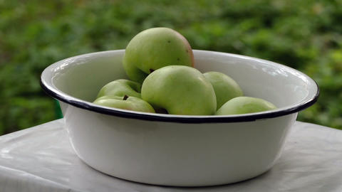 Apples fall in the white bowl Footage