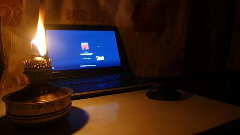 Kerosene lamp and computer - off Footage