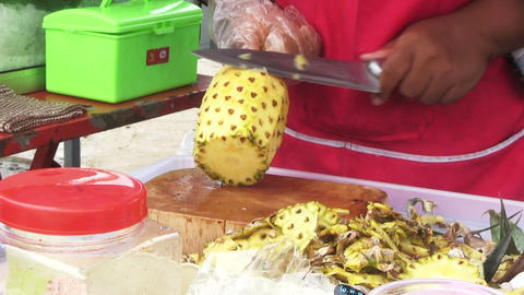 Woman Cutting Pineapple stock footage