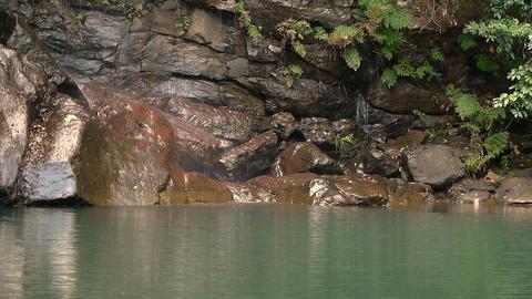 small waterfall between rocks Footage