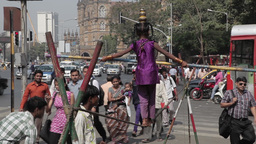 Indian Tightrope Walker In The City stock footage